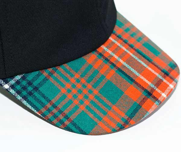 Tartan Baseball Peak Close-Up