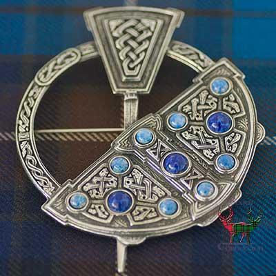 Celtic Penannular Brooch on Tartan